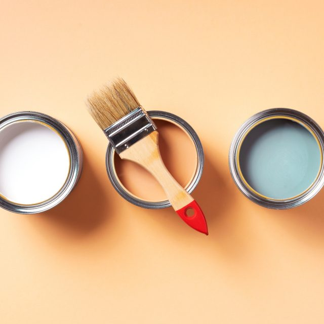 Paint brush and open paint can with on pastel background. Top view, copy space. Appartment