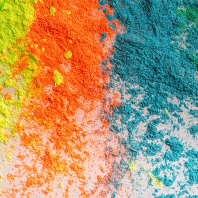 Placer of colorful holi powder for indian Spring festival on white